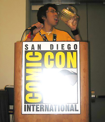 podium with the San Diego Comic Con logo and me drinking from a pitcher