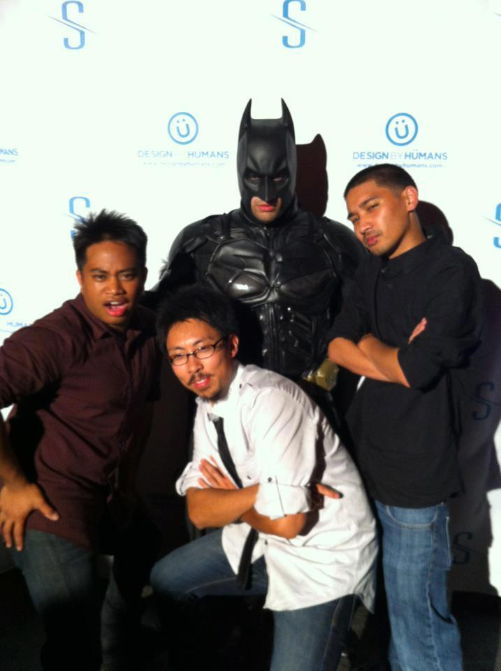 me and friends taking a picture with batman