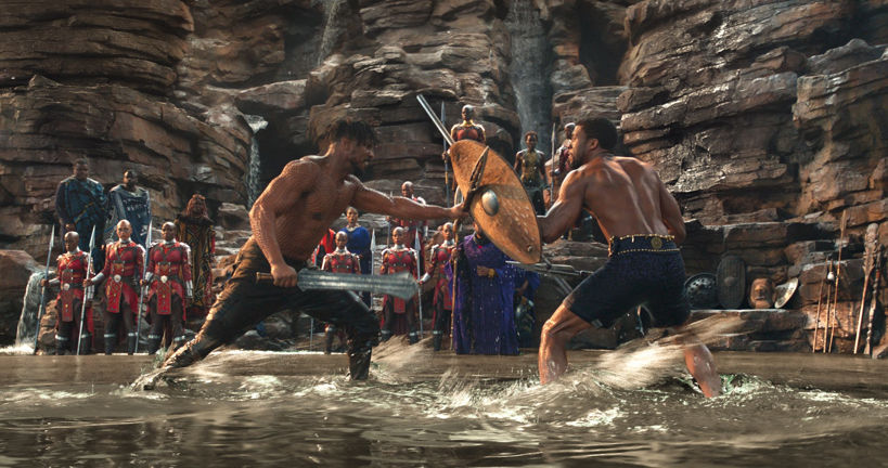 killomonger and t'challa fight in water, t'challa holds up his shield to block killmonger's sword