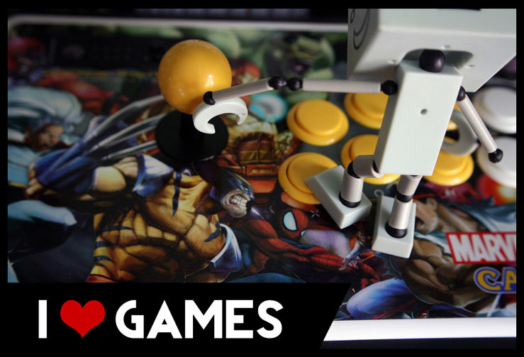 Games Header Image - robot stepping on an arcade fight stick