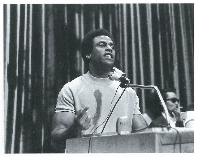 huey newton speaks at a podium