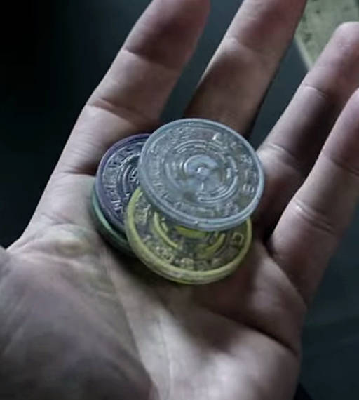 coins from ceres station in a hand