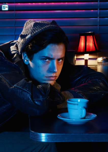 jughead with his head down and a cup of coffee