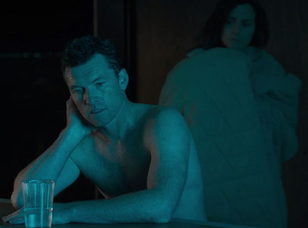 shirtless rick sweats as he overheats while abi is bundled up in a blanket behind him