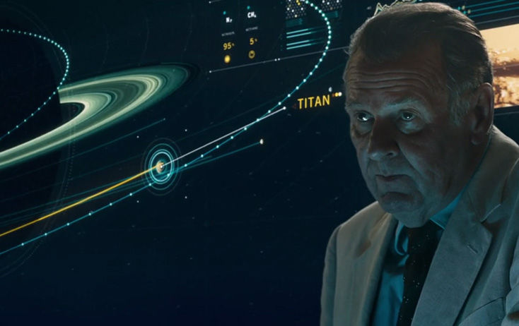 professor collingwood in front of a screen showing titan