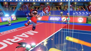 mario jumps for the tennis ball